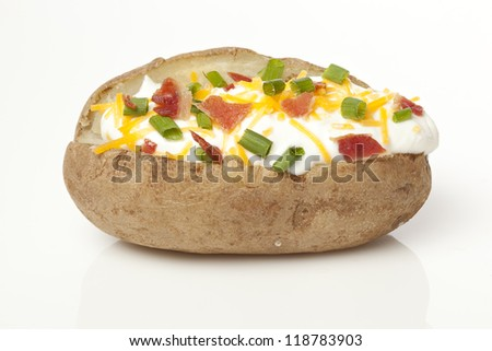 Hot Baked Potato with chives, cheese, and sour cream - stock photo