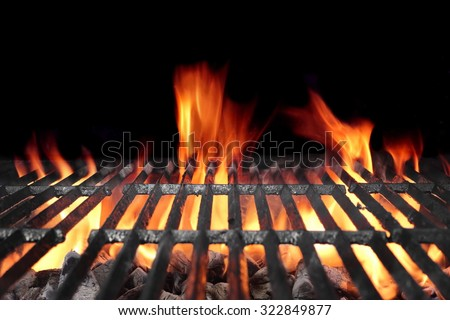 Hot Barbecue Charcoal Grill With Bright Flames Isolated On Black Background - stock photo