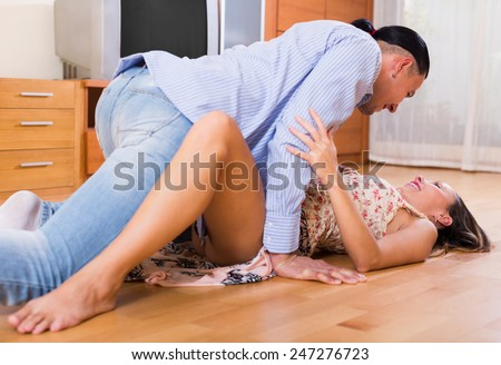 Hot beautiful girl making love with her colleague at office - stock photo