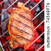 Hot beefsteak on barbecue - stock photo