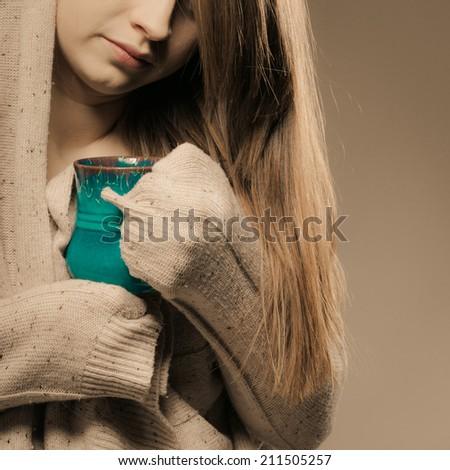 Hot beverage. Closeup of girl drinking cup mug of drink tea or coffee. Woman warming herself - stock photo
