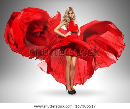 hot blond woman in beautiful red dress - stock photo
