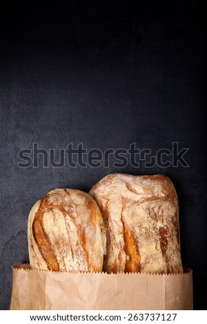 hot bread in paper bag . copy space - stock photo