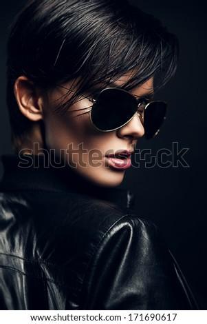 hot brunette woman in black sunglasses - stock photo