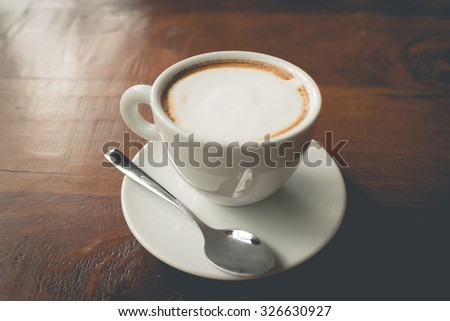 Hot cappuccino coffee on wood table ( Filtered image processed vintage effect.) - stock photo