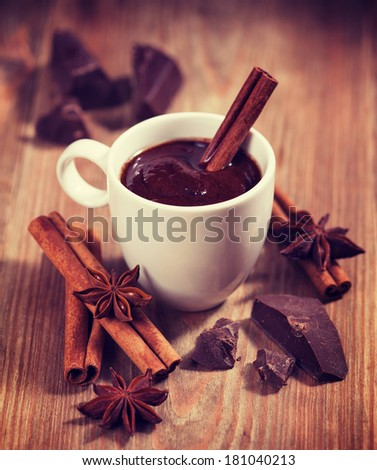 Hot chocolate, chocolate chips, cinnamon and star anise. Vintage retro hipster style version - stock photo