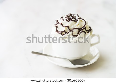 Hot chocolate cup with whipped cream on top - selective focus - stock photo