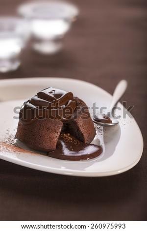 Hot chocolate fondant lava cake pudding - stock photo