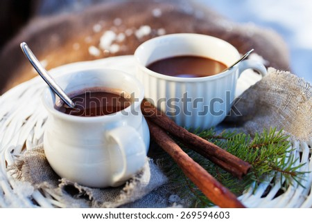 Hot chocolate for two outdoors - stock photo