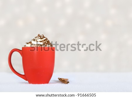 hot chocolate in a red mug on a winter background - stock photo