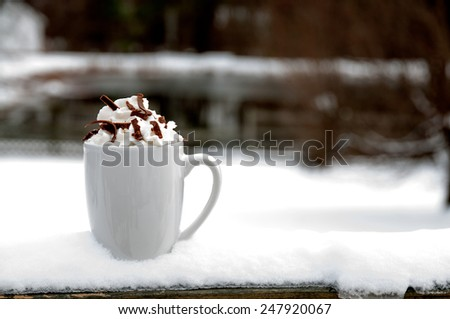 Hot Chocolate or Coffee on a winter snow day - stock photo