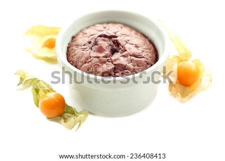 Hot chocolate pudding with fondant centre isolated on white - stock photo