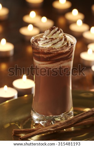 hot chocolate with cream and cinnamon flavouring - stock photo