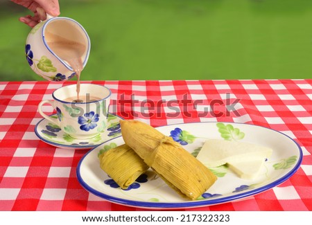 Hot chocolate with envueltos and cheese. - stock photo