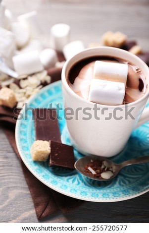 Hot chocolate with marshmallows in mug, on color wooden background - stock photo