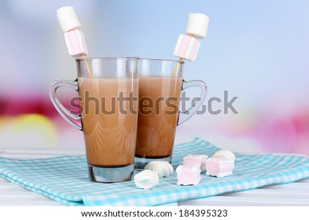 Hot chocolate with marshmallows, on light background - stock photo