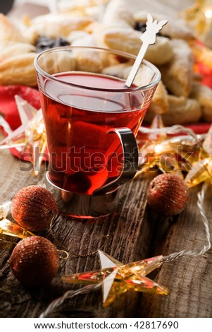 Hot Christmas drink glogg and traditional finnish pastry - stock photo
