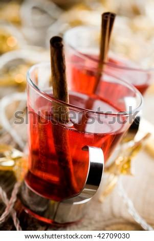 Hot christmas drink glogg with cinnamon sticks - stock photo