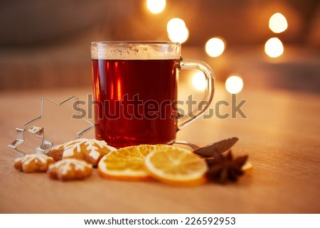 Hot christmas drink with spices and gingerbread, very shallow focus - stock photo