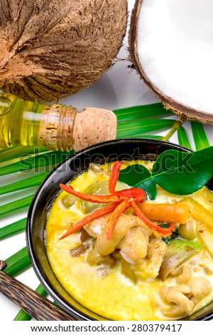 Hot coconut chicken soup with chili and curry In a bowl - stock photo