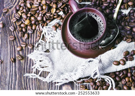 Hot coffee and coffee beans - stock photo
