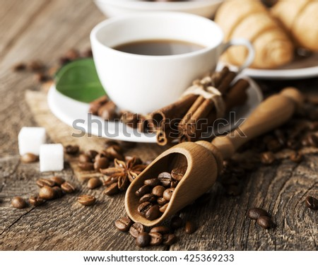 Hot coffee and pastries on a wooden background - stock photo