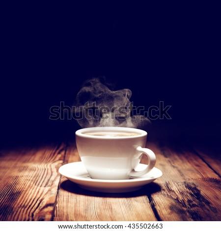 hot coffee and smoke  - stock photo