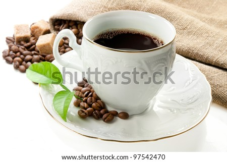 Hot coffee, coffee grains and brown sugar. - stock photo