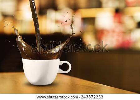 Hot Coffee Cup on Wood Table in Coffee Shop - stock photo