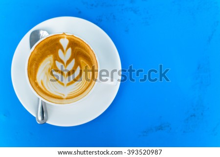 Hot coffee from top view on blue wood background - stock photo