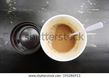 hot coffee in paper cup seen from top - stock photo