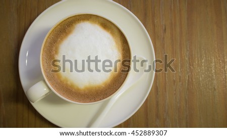 Hot coffee in the ceramic cup on the table. - stock photo