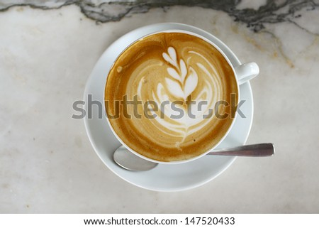Hot coffee latte on marble  background - stock photo