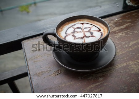 Hot coffee mocha with foam milk art in afternoon break.(selective focus, vintage effect) - stock photo
