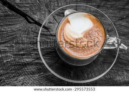 Hot coffee on a wooden stump - stock photo