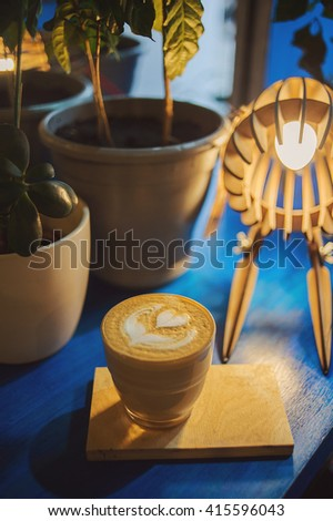 Hot coffee on the table in cafe, warm vintage tone, top view. - stock photo
