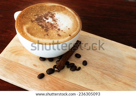 Hot coffee on wooden table in coffee shop. - stock photo