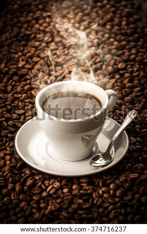 Hot coffee with beans background with spoon - stock photo