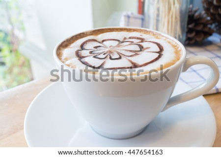 hot coffee with foam milk art. Black cup of coffee. Hot coffee in afternoon break. Coffee cup. coffee mocha on the wood desk. Coffee break.(selective focus, vintage effect) - stock photo