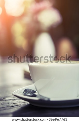 hot coffee with sunshine soft focus background - stock photo