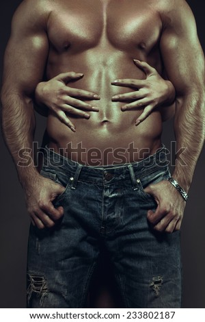 Hot couple at night, woman hands embracing sexy man abs, vintage style - stock photo