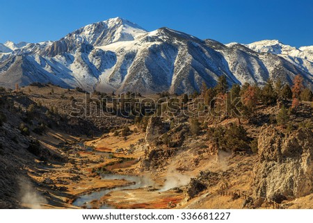 Hot Creek with the Sierra Mountains, California, USA. - stock photo