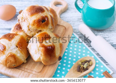 Hot Cross Buns on Wooden Board. Easter Card. Australian tradition. Rustic Style. - stock photo