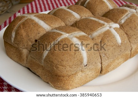 Hot cross buns to celebrate the Christian celebration of Easter. - stock photo