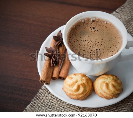 Hot cup of  coffee  on sack with cookies - stock photo