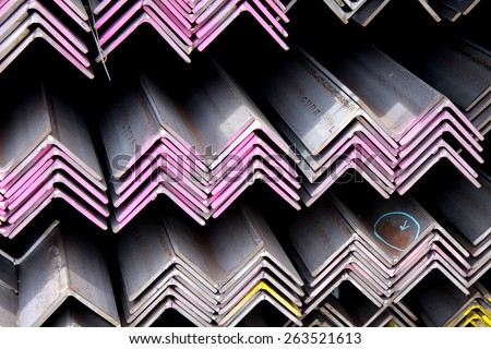 Hot-dip galvanized steel angle bunch on the rack in warehouse before shipment - stock photo