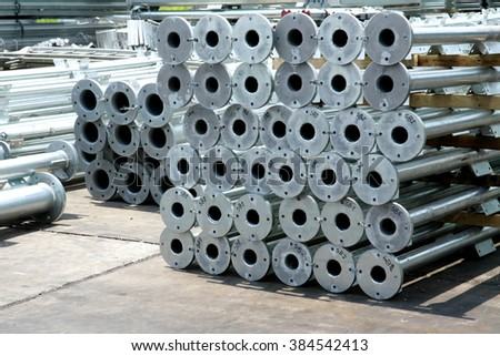 Hot-dip galvanized steel pipes bunch on the rack in warehouse before shipment - stock photo