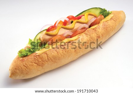 hot dog with bread, mustard and vegetable - stock photo