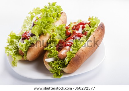 hot dog with lettuce and onions - stock photo