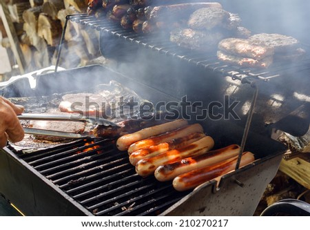 Hot dogs and Burgers on the Grill - stock photo